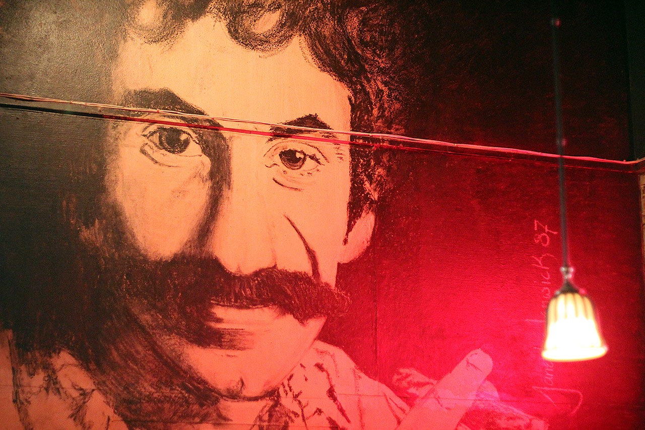 Jim Croce Painting on Wall with Cigar